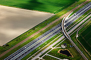 Nederland, Zeeland, Vlissingen-Oost, 09-05-2013; Nieuwe Sloelijn, goederenspoorlijn tussen het Sloegebied en de spoorlijn tussen Roosendaal en Vlissingen (Zeeuwse lijn). Viaduct over A58.<br /> New Sloelijn, freight railway line between the harbor and the railway line between Vlissingen and Roosendaal (Zeeland line).<br /> luchtfoto (toeslag op standard tarieven);<br /> aerial photo (additional fee required);<br /> copyright foto/photo Siebe Swart.