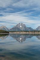 Mount Moran reflected in still waters of Jackson Lake, Grand Teton National Park Wyoming