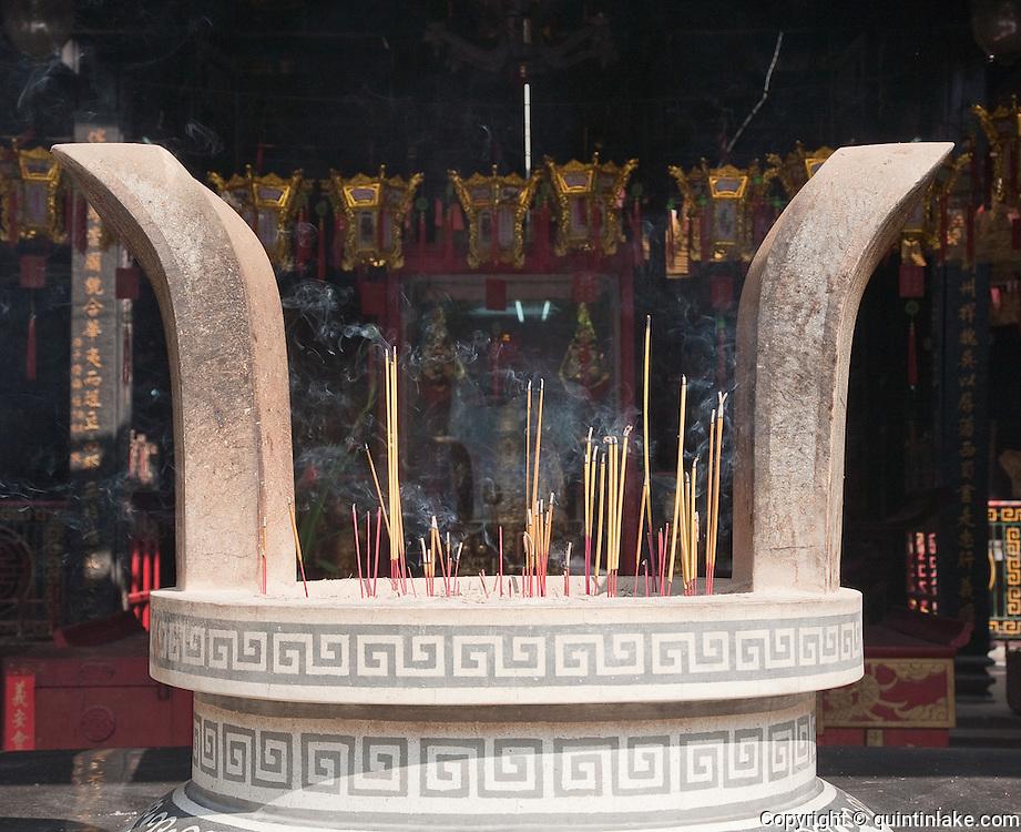 Incense burning in stone urn,  Nghia An Hoi Quan Pagoda on 678 Nguyen Trai Street in Cholon, Ho Chi Minh City