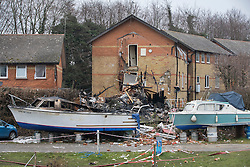 © Licensed to London News Pictures. 15/02/2017. Oxford, UK. Rubble, debris and a burnt out boat is seen next to the remains of a block of flats damaged in an explosion near Osney Lock in Oxford. A number of people have been injured in what is thought to have been a gas explosion. Photo credit: Peter Macdiarmid/LNP
