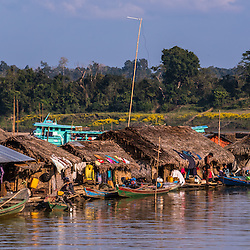 It's said that Myanmar has the most favorable agricultural conditions in all of Asia. This image shows the rural area life in the near of Monywa Tonwship on the Chindwin river. During dry season, many villagers venture to the riverbanks to settle for some months, growing certain kinds of vegetables and fish for their daily needs. In this connection, it is important to note that Myanmar agriculture is characterized by small-scale, subsistence, family farming. Other outlets like this one are specialised in catching larger amount of small fish to sell it in the nearby villages.