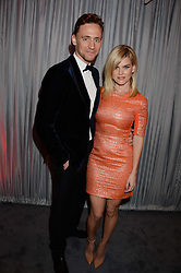 TOM HIDDLESTONE and ALICE EVE at the GQ Men of The Year Awards 2013 in association with Hugo Boss held at the Royal Opera House, London on 3rd September 2013.