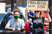 """Anti Brexit campaigners holds up a banner outside Parliament in Central London on Wednesday, July 22, 2020. <br /> The British government - under the Conservative Party leadership of David Cameron, Theresa May and Boris Johnson - failed to conduct serious assessments of Russian attempts to interfere with British elections, including the 2016 Brexit referendum, according to the long-delayed """"Russia Report"""" released on Tuesday. (VXP Photo/ Vudi Xhymshiti)"""