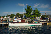 """1910 Goodhue and Hawkins 36' Laker """"Keen Kutter""""  owned by Dick and Patricia Hopgood sits at the dock during the annual antique boat show in Wolfeboro, New Hampshire.  ©2018 Karen Bobotas Photographer"""
