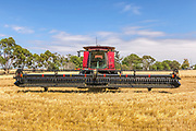 combine harvester in field after harvesting <br /> <br /> Editions:- Open Edition Print / Stock Image