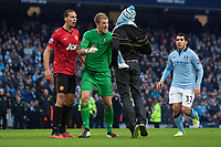 Football - 2012 / 2013 Premier League - Manchester City vs. Manchester United<br /> Joe Hart of Manchester City defends Rio Ferdinand of Manchester United against a pitch invader at the Etihad Stadium