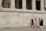 Small group of women walk past the reopened National Gallery as coronavirus lockdown easing continues on 25th May 2021 in London, United Kingdom. Museums and gelleries are now allowed to open once again, as people start to return to normal life.