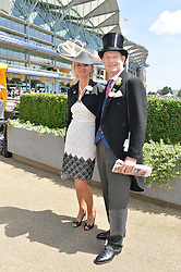 The EARL & COUNTESS OF DERBY at the first day of the 2014 Royal Ascot Racing Festival, Ascot Racecourse, Ascot, Berkshire on 17th June 2014.