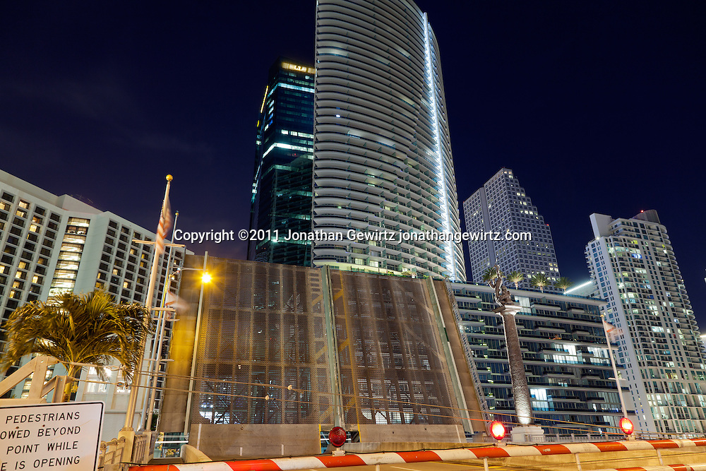 Night view looking North of the open Brickell Avenue drawbridge over the Miami River, with condo and office buildings. WATERMARKS WILL NOT APPEAR ON PRINTS OR LICENSED IMAGES.