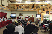 Jim Julia, (foreground in white shirt) talk with potential bidders at the October 2010 Firearms Auction.