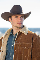 hot cowboy looking off outdoors