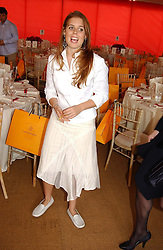 Right, PRINCESS BEATRICE OF YORK at the Veuve Clicquot sponsored Gold Cup or the British Open Polo Championship won by The  Azzura polo team who beat The Dubai polo team 17-9 at Cowdray Park, West Sussex on 18th July 2004.