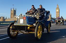 Participants in the Bonhams London to Brighton Veteran Car Run pass Big Ben as they drive over Westminster Bridge in London.