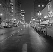 Y-581226A-10. Night view of SW 6th looking south from Washington. December 26, 1958.