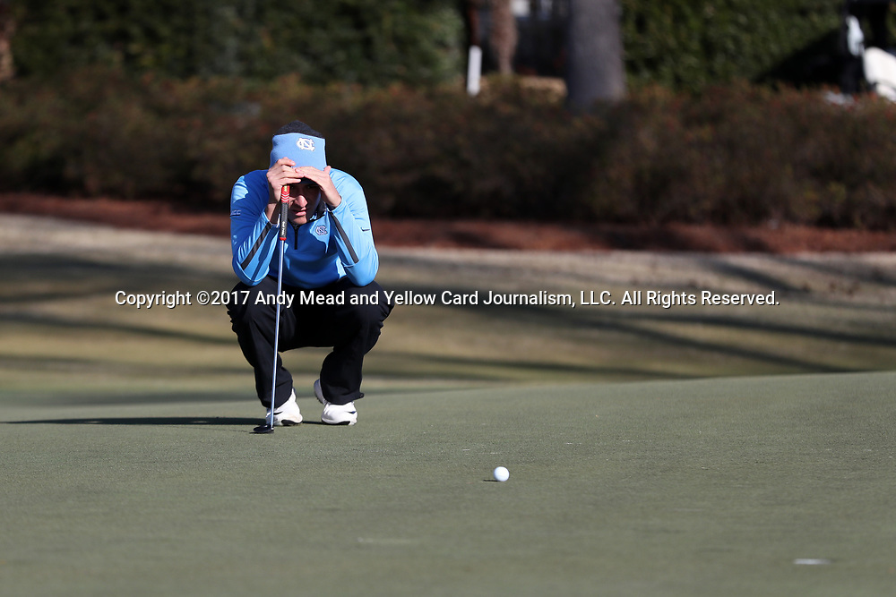 WILMINGTON, NC - MARCH 19: North Carolina's Jose Montano (BOL) lines up his putt on the Ocean Course fourth hole. The first round of the 2017 Seahawk Intercollegiate Men's Golf Tournament was held on March 19, 2017, at the Country Club of Landover Nicklaus Course in Wilmington, NC.