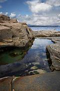 Coastal rockpool, Mullaghmore Co. Sligo, mirroring the sky