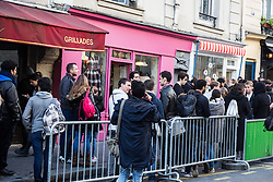 The first customers are queueing up outside view of popcorn store 'YummyPop' in the Marais district on its opening day, in Paris, France on October 22, 2016. Hollywood actress Scarlett Johansson opened together with her French husband, advertising executive Romain Dauriac, her own gourmet popcorn store, selling treats includingpopcornflavoured with Vermont cheddar, truffle, parmesan and sage. Photo by ABACAPRESS.COM