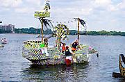 Family enjoying themselves on milk carton sailboat on Lake Calhoun. Aquatennial Beach Bash Minneapolis Minnesota USA