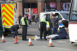 A man fell from the pavement in front of an Edinburgh Tram causing the closure of Princes Street and diversion of traffic away from the scene.