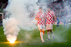 14-06-2012 VOETBAL: UEFA EURO 2012 DAY 7: POLEN OEKRAINE<br /> Flares and players Ivan Perisic of Croatia and Ognjen Vukojevic  of Croatia  during the Euro 2012 football championships match Italy v Croatia at the stadium in Poznan. <br /> ***NETHERLANDS ONLY***<br /> ©2012-FotoHoogendoorn.nl