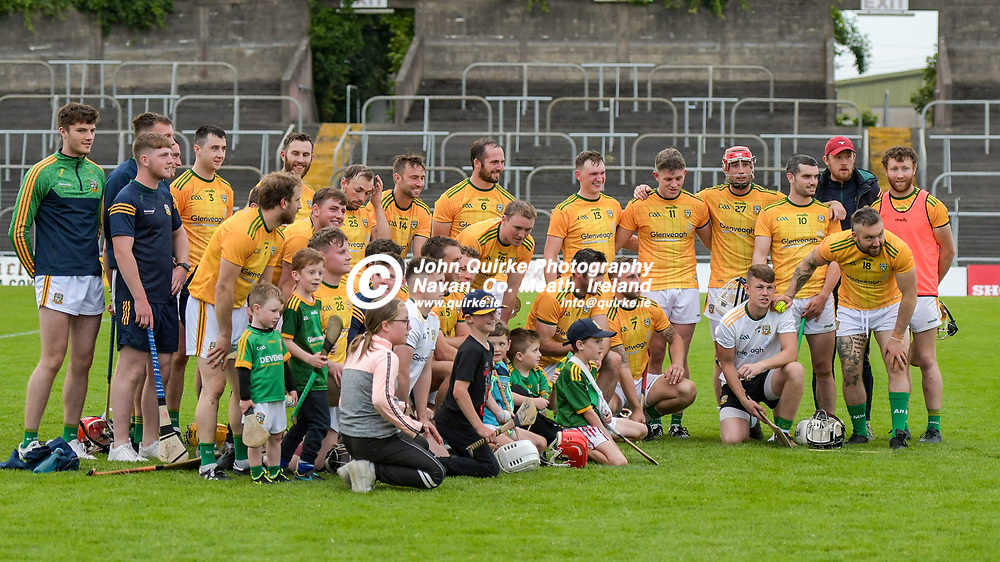 Meath players pose for a photo, after the game, with some of the children that attended  the Meath v Kerry,  Joe McDonagh Cup match at Pairc Tailteann, Navan.<br /> <br /> Photo: GERRY SHANAHAN-WWW.QUIRKE.IE<br /> <br /> 10-07-2021