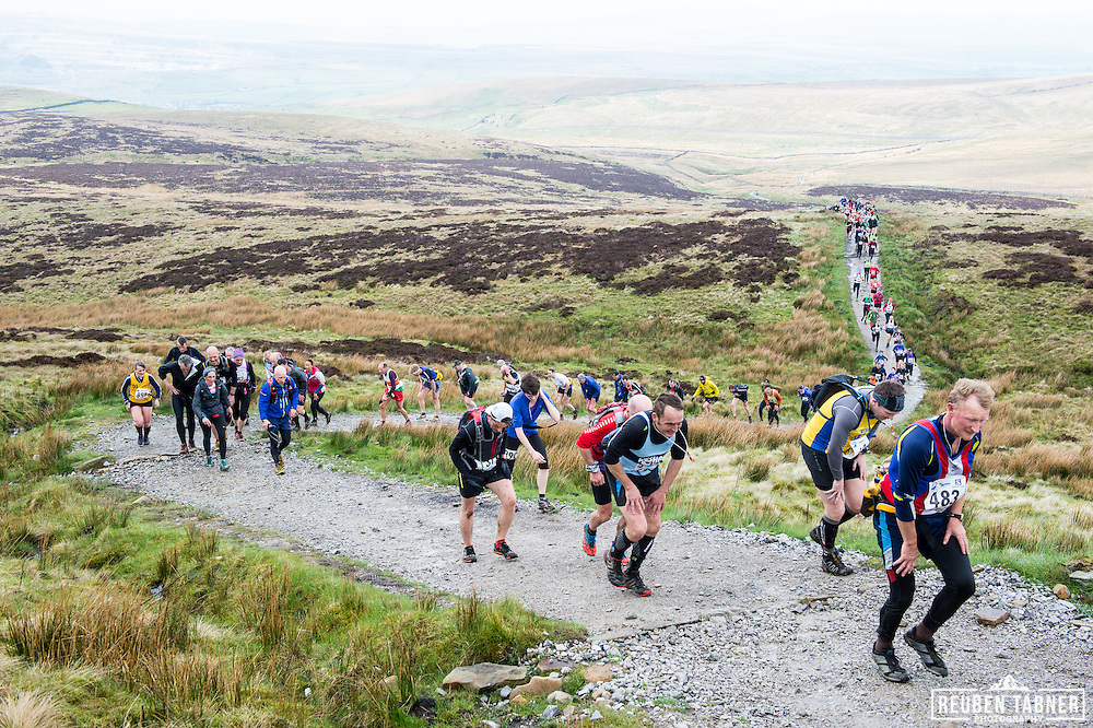 Runners wind their way up the main steep section on Pen-y-ghent in the Yorkshire Dales during the 60th Yorkshire Three Peaks Race.