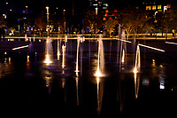 Water Fountains at Darling Harbour with reflections at Night