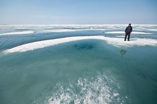Peter Kapolak on the flow ice near Elu Inlet, Nunavut, Canada