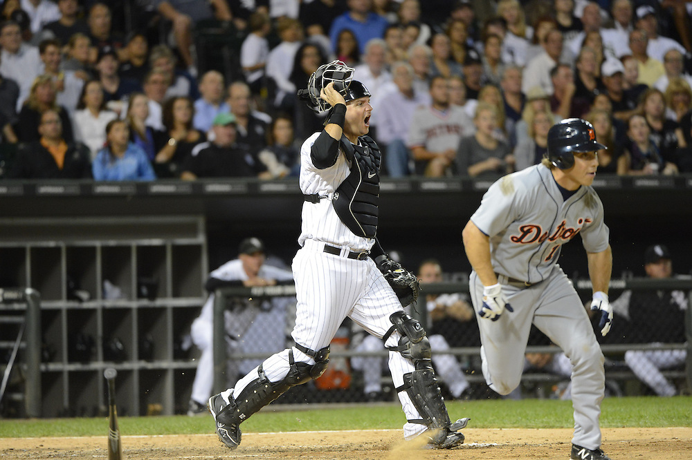 CHICAGO - SEPTEMBER 11:  A.J. Pierzynski #12 of the Chicago White Sox catches against the Detroit Tigers on September 11, 2012 at U.S. Cellular Field in Chicago, Illinois.  The Tigers defeated the White Sox 5-3.  (Photo by Ron Vesely)  Subject:  A.J. Pierzynski