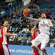Anadolu Efes's Dogus Balbay (R) during their Turkish Basketball League match Anadolu Efes between Erdemir at Arena in Istanbul, Turkey, Wednesday, January 28, 2012. Photo by TURKPIX