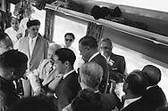 1959. Nikita Kruschev walking through train giving impromptu remarks to the Press.<br /> <br /> 1959. Nikita Khrouchtchev marchant à travers le train pour delivrer des remarques impromptus à la presse .