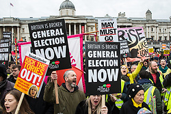 London, UK. 12th January, 2019. Hundreds of protesters, many wearing yellow vests, take part in a 'Britain is Broken: General Election Now' demonstration organised by the People's Assembly Against Austerity. Organisers argued that the overriding objective of working people in the UK should be to remove the Conservative Government from power through a general election regardless of their vote in the EU referendum.