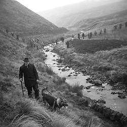A police-mounted search of Saddleworth Moor, near Woodhead, for the bodies of the victims of the Moors Murderers.