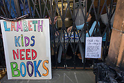 Young occupiers campaigning aginst the closure by Lambeth council of Carnegie Library play board games inside the front gates in Herne Hill, south London on 2nd April 2016. The angry local community in the south London borough have occupied their important resource for learning and social hub for the weekend. After a long campaign by locals, Lambeth have gone ahead and closed the library's doors for the last time because they say, cuts to their budget mean millions must be saved. A gym will replace the working library and while some of the 20,000 books on shelves will remain, no librarians will be present to administer it. London borough's budget cuts mean four of its 10 libraries will either close, move or be run by volunteers. (Photo by Richard Baker / In Pictures via Getty Images).