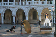 Newly Wed couple in St Mark's Square being photographed.Venice, Italy, Europe
