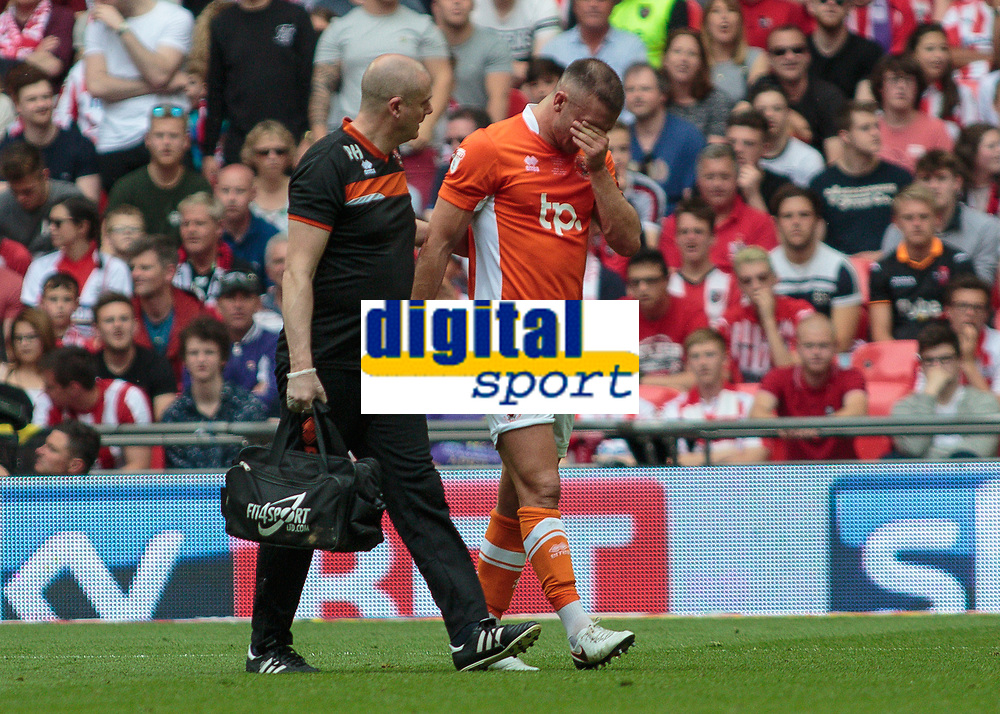 Football - 2017 Sky Bet [EFL] League Two Play-Off Final - Blackpool vs. Exeter City<br /> <br />  Tom Aldred of Blackpool  breaks down as he is led from the field by the physio at Wembley.<br /> <br /> COLORSPORT/DANIEL BEARHAM