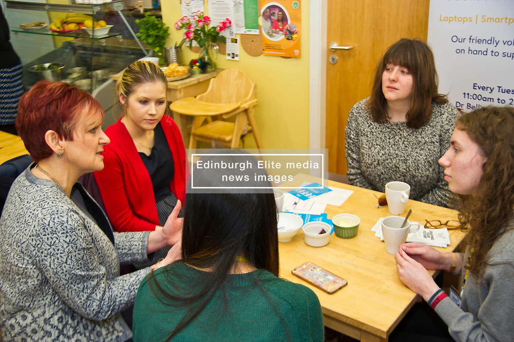 Pictured: Angela Constance, Communities Secretary had the opportunity to chat with Digital Drop In volunteer Students, Orla Landy (red cardigan), Nicole Nq (green top), Mirriam Ochoa (grey top shoulder length hair) and Anastaija Nikolajeva (grey top and long hair)<br /> Today Communities Secretary  Angela Constance visited Dr Bells family centre, where she met staff and volunteers ahead of the first Tackling Child Poverty Delivery Plan being published.<br /> <br /> <br /> Ger Harley   EEm 29 March 2018