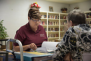 DURANT, OKLAHOMA - MARCH 24:  Sheila Risner goes through paperwork for food deliveries at the Bryan County Retired Senior Volunteer Program in Durant, Oklahoma on March 24, 2017. (Photo by Cooper Neill for The Washington Post)