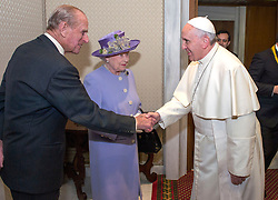The Duke of Edinburgh shakes hands with Pope Francis as Queen Elizabeth II arrives for a meeting at the Vatican.