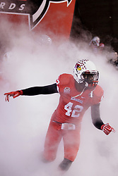11 December 2015:  Soniel Estime(42) takes the field amidst the smoke in front of the tunnel.  NCAA FCS Quarter Final Football Playoff game between Richmond Spiders and Illinois State Redbirds at Hancock Stadium in Normal IL (Photo by Alan Look)