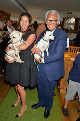 SIR DAVID & LADY TANG with their dogs Lily & Norts at A Date With Your Dog At George in aid of the Dogs Trust held at George, 87-88 Mount Street, London on 9th September 2014.