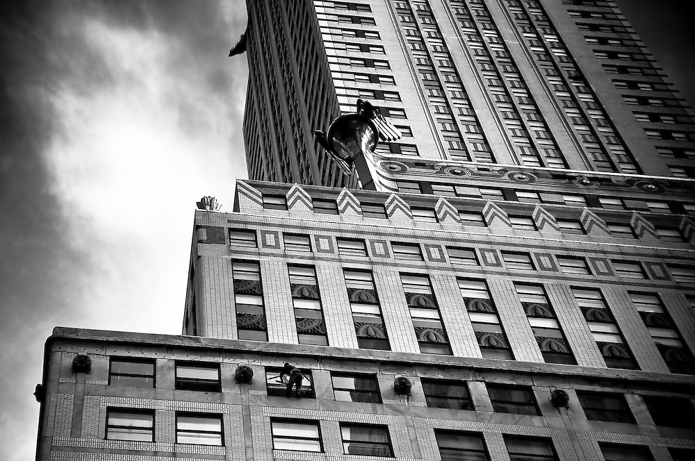 A window cleaner hangs up on the Chrysler building in Midtown manhattan, New york, 2009.