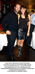 Model KELLY BROOK and JASON STATHAM, at a party in London on 12th January 2004.PPT 52