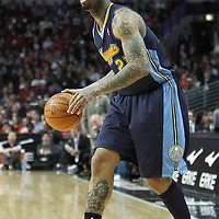 26 March 2012: Denver Nuggets small forward Wilson Chandler (21) looks to pass the ball during the Denver Nuggets 108-91 victory over the Chicago Bulls at the United Center, Chicago, Illinois, USA. NOTE TO USER: User expressly acknowledges and agrees that, by downloading and or using this photograph, User is consenting to the terms and conditions of the Getty Images License Agreement. Mandatory Credit: 2012 NBAE (Photo by Chris Elise/NBAE via Getty Images)