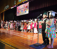 Alyse Izzo, right, and Daniel Dusevic lead the Pledge of Allegiance at the start of the kindergarten graduation in the auditorium at Minisink Valley Elementary School in Slate Hill on Tuesday, June 19, 2012. About 700 relatives and friends watched 167 students graduate.