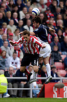 Photo: Jed Wee.<br />Sunderland v West Bromwich Albion. The Barclays Premiership. 17/09/2005.<br /><br />West Brom's Jonathan Greening (R) goes in hard to win the ball from Sunderland's Dean Whitehead.