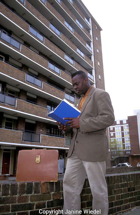 Social worker visiting clients on housing estate London.