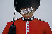 Anti-vaxxer defaced Grenadier Guard poster during the coronavirus or Covid-19 pandemic reads This only ends when you take off your muzzle and stop complying on 2nd July 2021 in London, United Kingdom. After months of lockdown, and easing beginning, social distancing measure and signage are still in place, much to the consternation of local anti-vaccine supporters. Among vaccine hesitancy are groups known as anti-vaxxers or anti vax, who are generally against vaccination.
