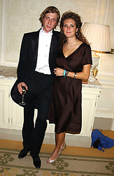 PRINCE MAX ZU SALM and MISS LEONORA BEAMISH at a dinner hosed by Moet & Chandon at their headquarters at 13 Grosvenor Crescent, London on 12th October 2005.<br />