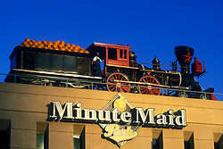 Stock photo of the conductor and train with oranges on the top of Minute Maid Park in Houston Texas